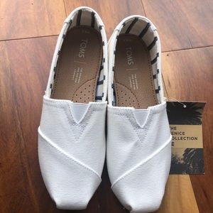Toms white canvas shoes